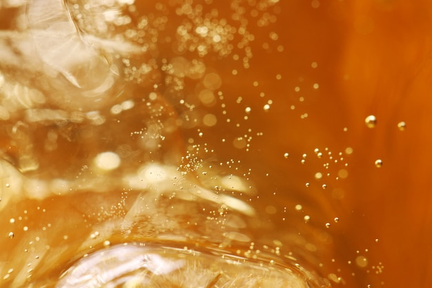 Whisky and ice in glass, bubble float