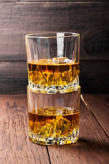 Whisky with ice in two glasses
