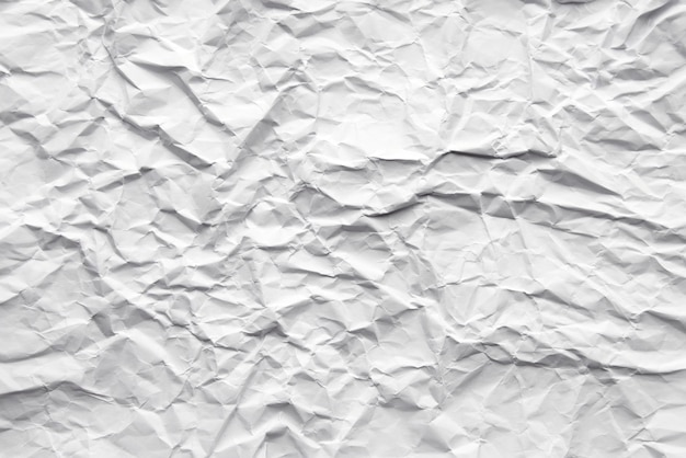 White abstract crumpled paper background.