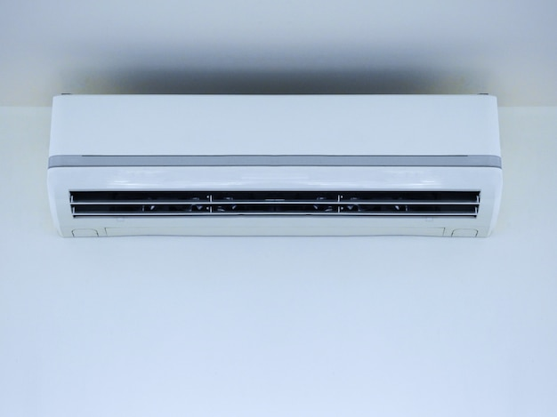 White air conditioner on wall background