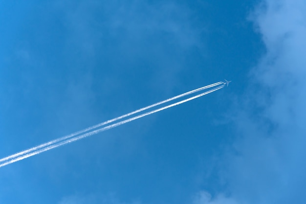 White aircraft big two engines aviation airport contrail clouds.
