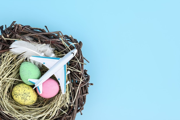 White airplane and easter egg nest flatlay