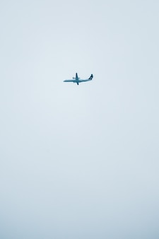 White airplane flying in the sky