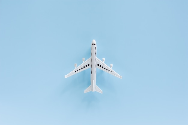 White airplane model on blue for vehicle and transportation concept