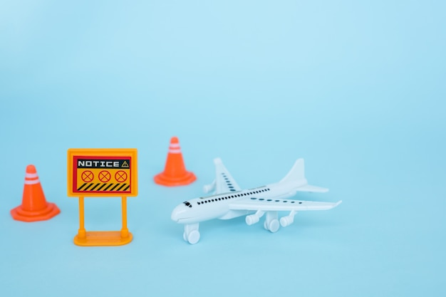 White airplane model with prohibition sign on blue background for vehicle and transportation