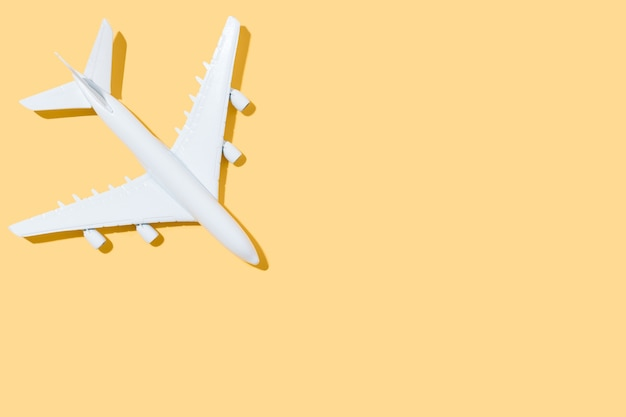 White airplane on a yellow background travel and summer concept 3d illustration copy space