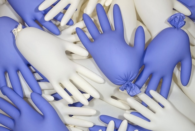 白と青の医療用ラテックス手袋の背景