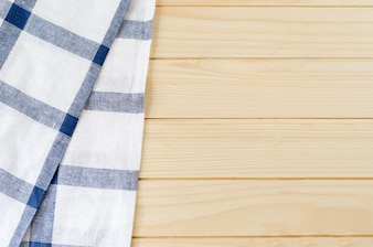 White and blue napkin on wooden table