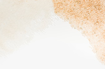 White and brown uncooked rice on white background