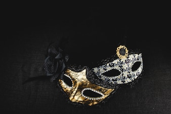 White and golden mask on a dark background