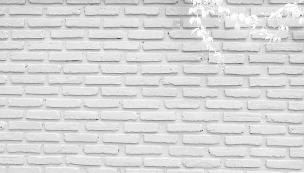 Белая и серая предпосылка текстуры кирпичной стены с космосом для текста. обои из белого кирпича.