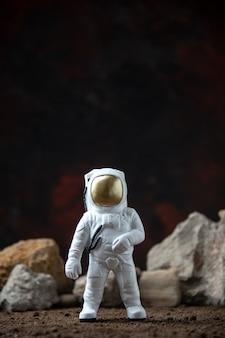 White astronaut with rocks on moon dark  fantasy sci fi