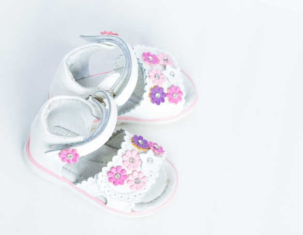 White baby shoes on a white background