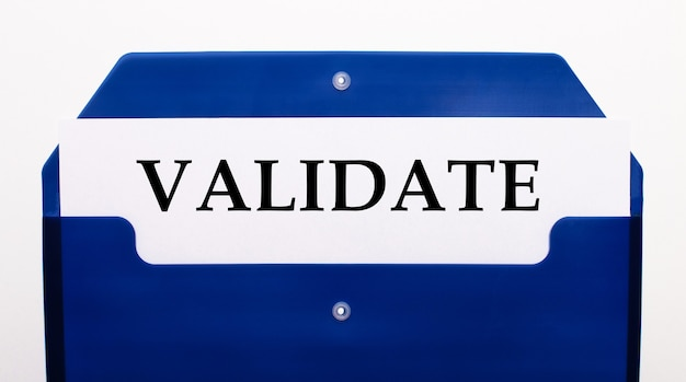 On a white background, a blue folder for papers. in the folder is a sheet of paper with the word validate
