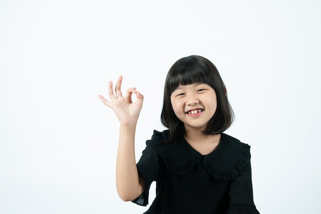 White background, child's fingers okay.