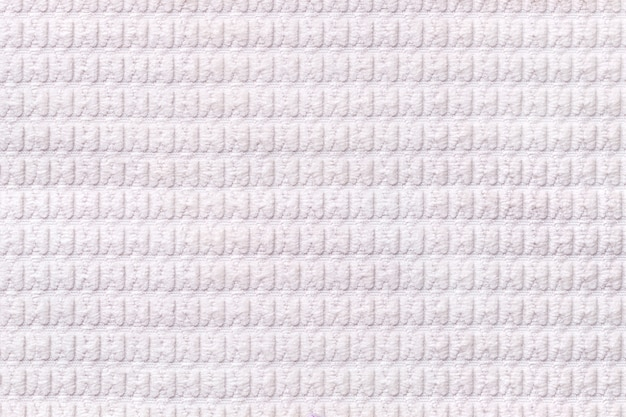 White background from soft fleecy fabric close up, texture of textiles