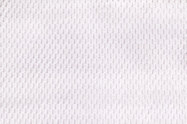 White background from soft fleecy fabric closeup. texture of textile macro