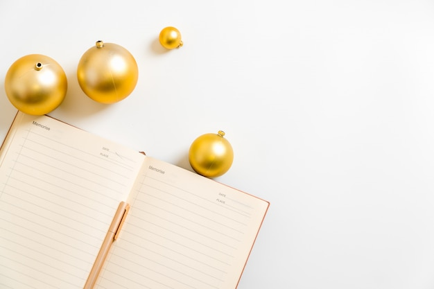White background notepad handwriting new year resolution golden ball planning life goals 2019 2020