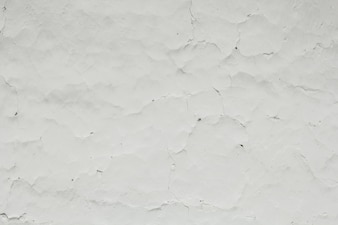 White background of cracked plaster.