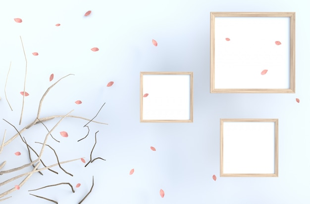 White background with picture frame and blow pink leaves, branch.
