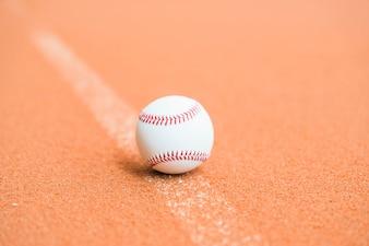 White baseball on pitch