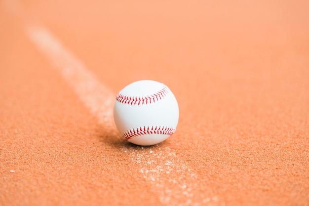 White baseball on pitch