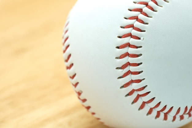 White baseball with red thread. make baseball bindings.