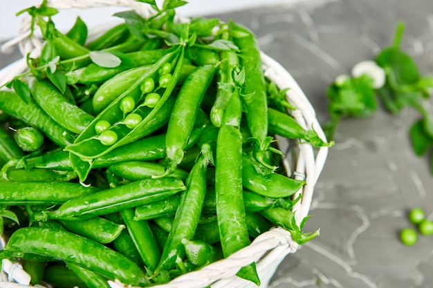 White basket with fresh green peas