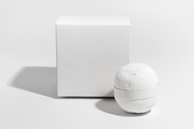 White bath bomb with its box