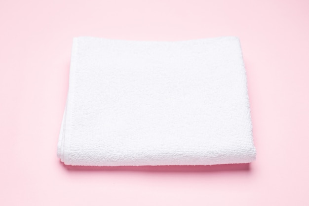 White bath towel on pink