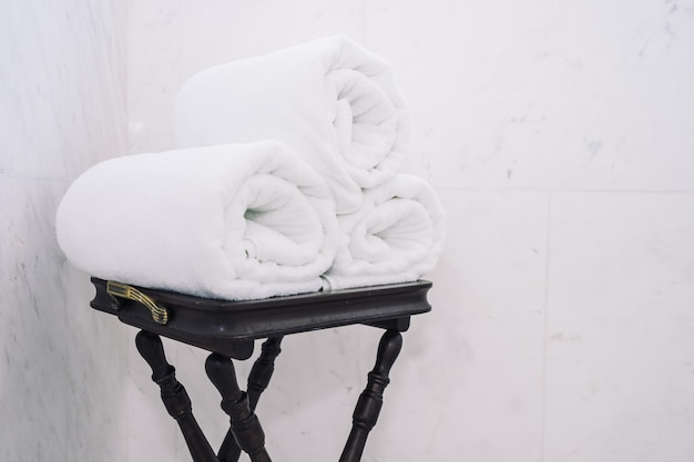 White bath towel on table
