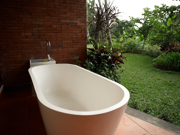 White bathroom on the porch room design togetherness with nature landscape in the background
