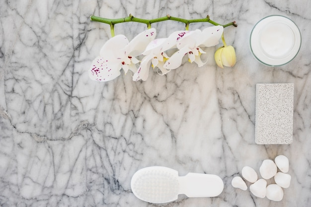 White bathroom products on marble surface