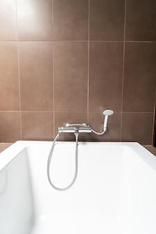 White bathtub decoration in bathroom interior