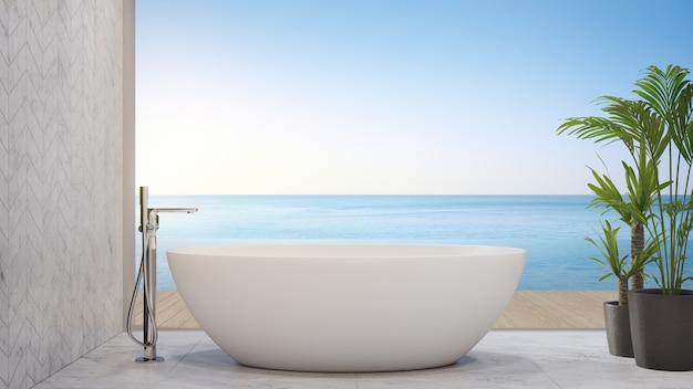 Белая ванна на мраморном полу возле террасы бесконечного бассейна в современном пляжном домике
