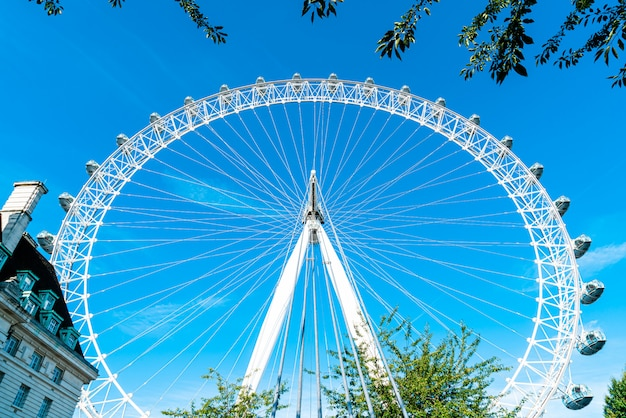 White beautiful large ferris wheel with blue sky