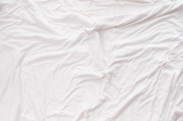 Белый постельное белье текстуру фона.
