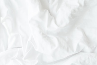 White bedding sheets or white fabric wrinkle texture background,soft focus