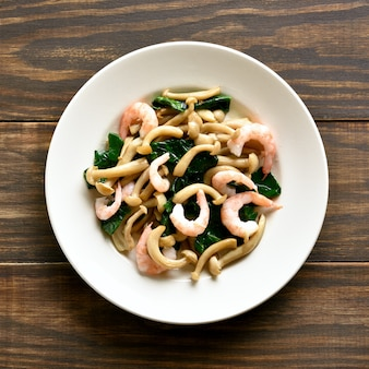 White beech mushrooms with leaves of spinach and shrimps