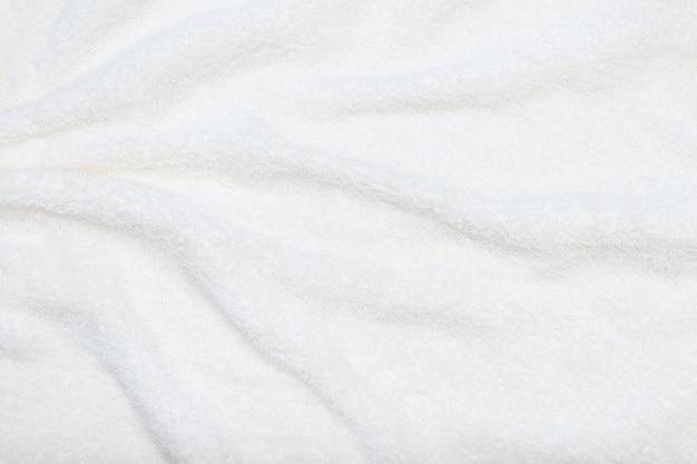 Белый бежевый нежный мягкий фон из плюшевой ткани.