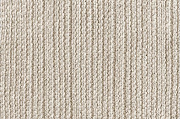 ホワイトベージュウール編み生地テクスチャ背景