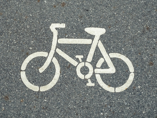 White bicycle symbol on the road