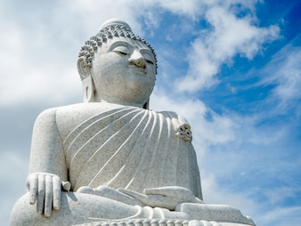 White Big Buddha with blue sky on top of the mountain at Phuket island Thailand