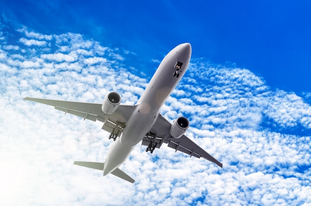 White big passenger airplane in the blue sky.