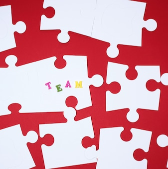 White big puzzles on red, inscription team