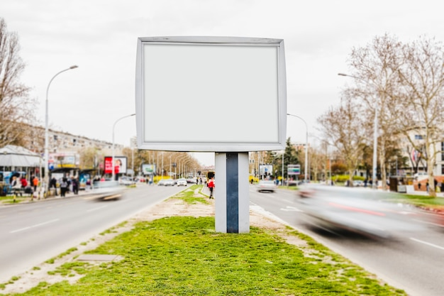 White billboard advertising mockup in busy street