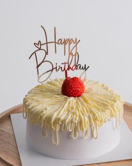 White birthday cake over light grey.food concept anniversary background.