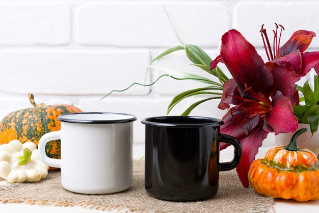 White and black campfire mug with pumpkin and red lily