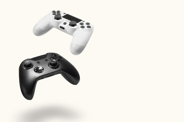 White and black game controllers on white wall