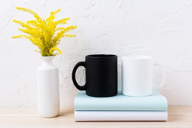 White and black mug mockup with ornamental yellow flowering grass